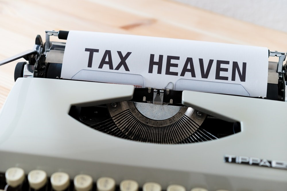 "A paper that reads ""Tax Heaven"" placed in a typewriter"